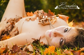 woman in leaves and sunshine