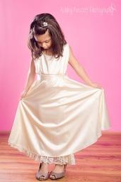 little girl in mommy's wedding dress
