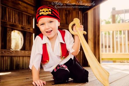 boy dressed as pirate at playground, fredericksburg child photographer