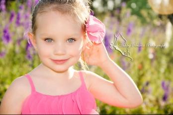girl with pink flower in her hair, child photographer in fredericksburg va