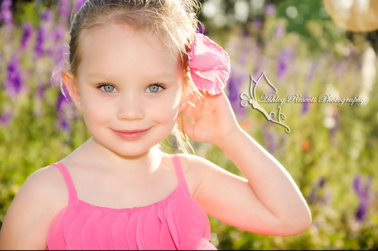 girl with pink flower in her hair, child photographer in fredericksburg va