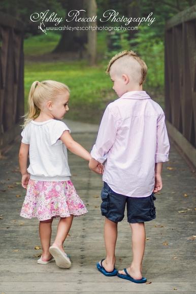 brother and sister holding hands on bridge, fredericksburg va children photographer