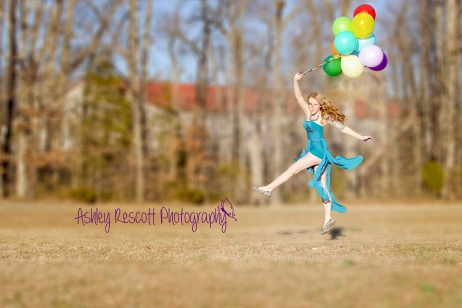 leaping in air with balloons