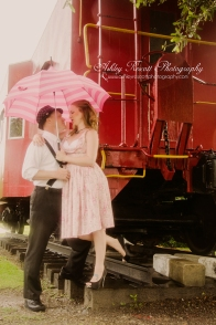 couple in rain at the train vintage, fredericksburg va couples photographer