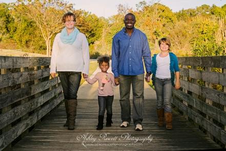 family walking across bridge, family photographer in fredericksburg va