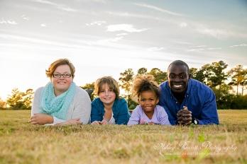 family laying in grass, fredericksburg va family photographer