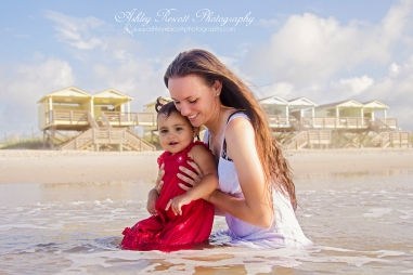 mother and daughter in the water at the beach, fredericksburg va photographer