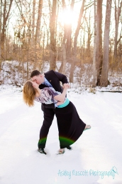 couple kissing and dipping in snow