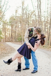 Dip and kiss on dirt road in woods