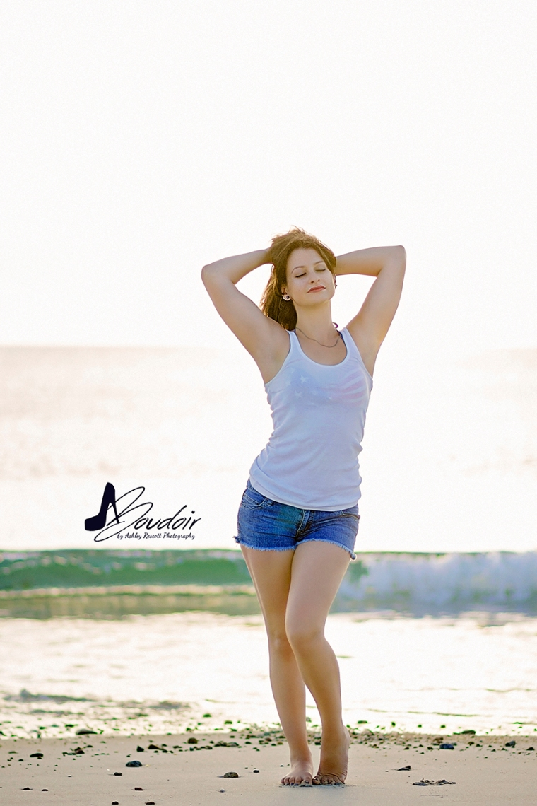 Girl in jean shorts and tank top on beach