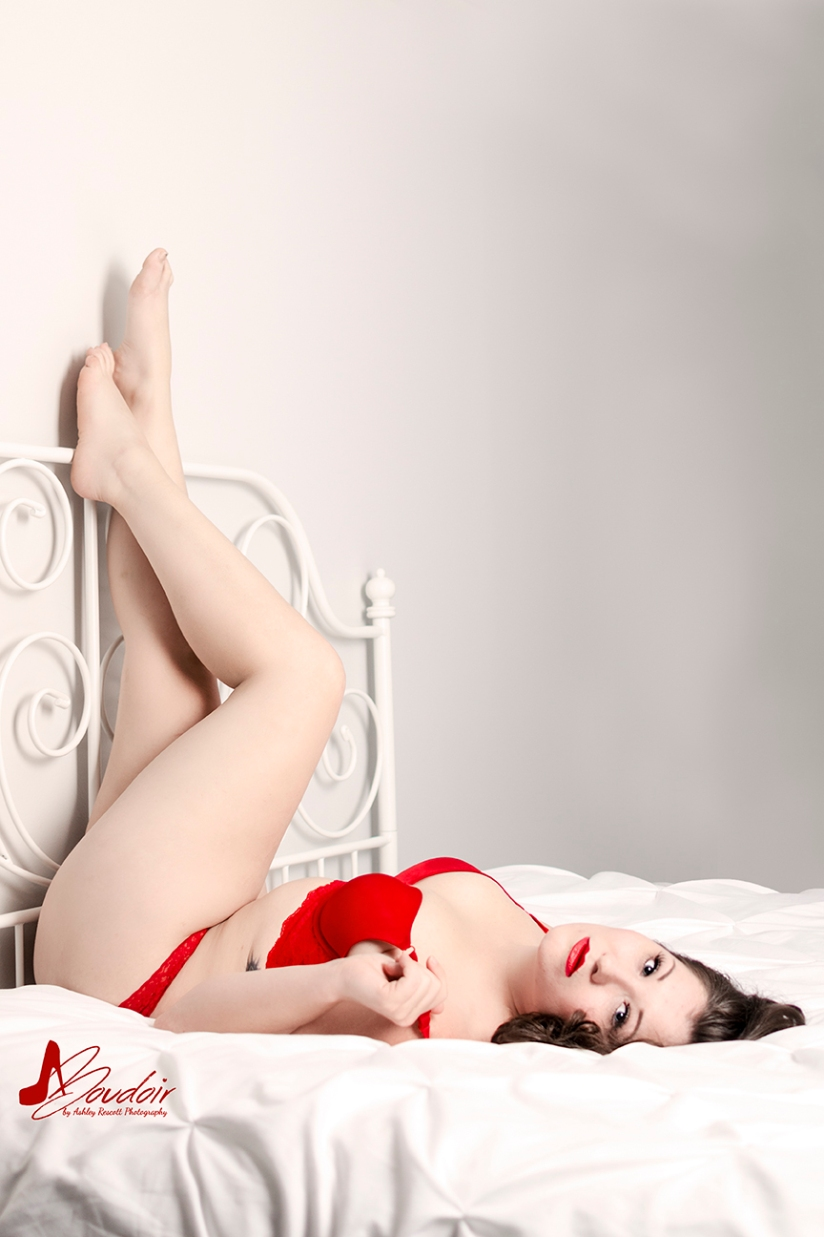 woman in red underwear with feet going up wall