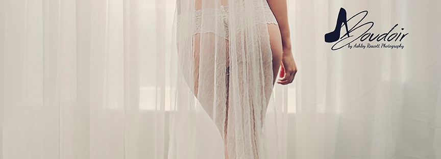 woman in veil and panties in front of window