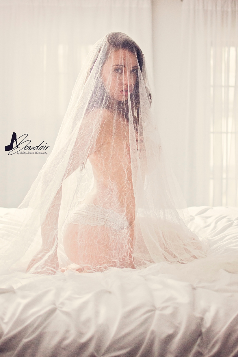 bride in veil and panties kneeling on bed
