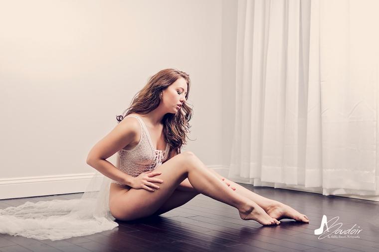 Bride in lingerie sitting on floor