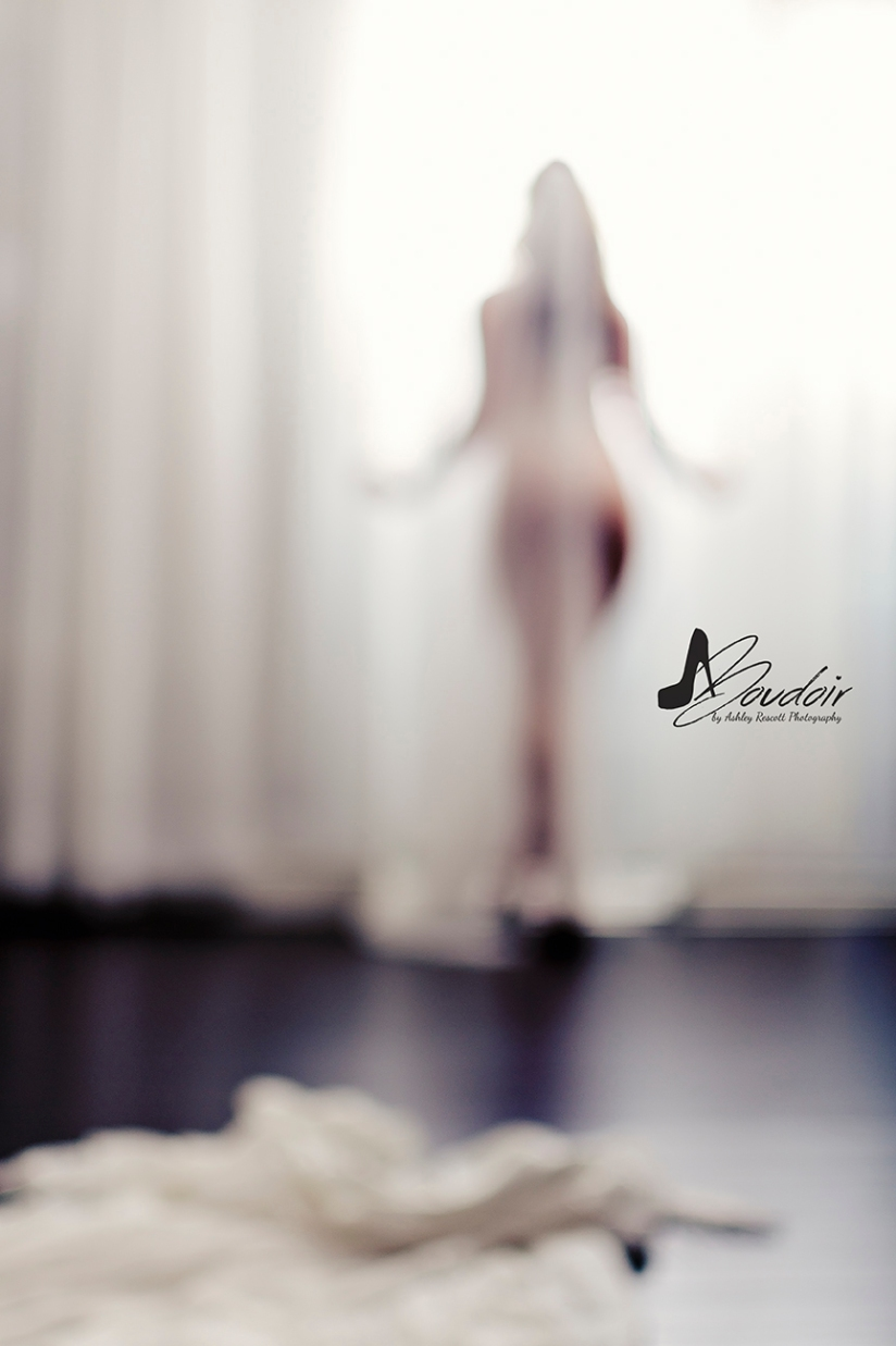blurry woman in front of window