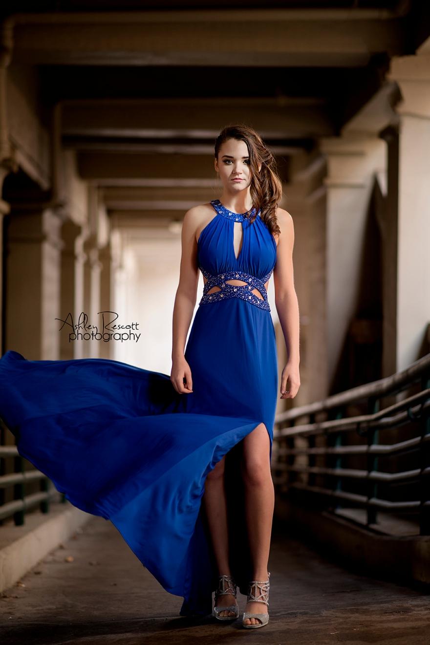 fierce high school senior girl in blue prom dress