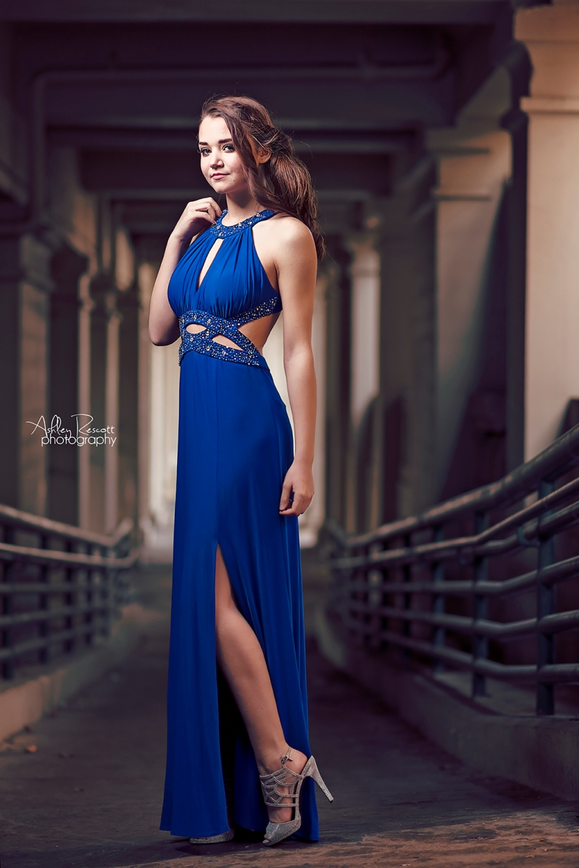 high school senior girl in blue prom dress and silver stilettos
