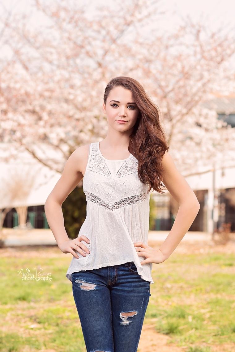 high school senior girl in front of cherry blossom tree
