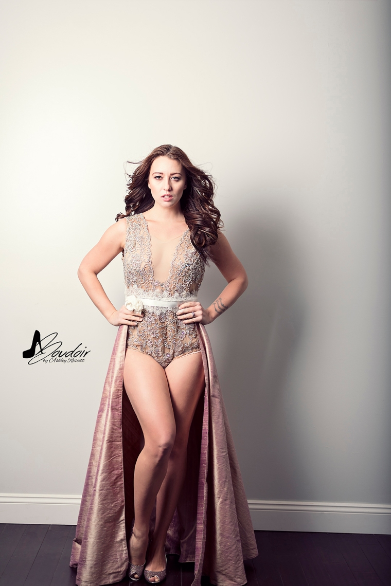brunette in body suit and cape skirt