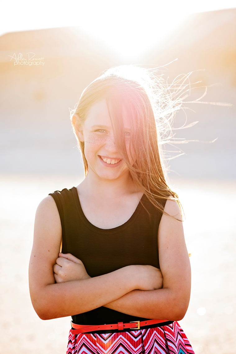 girl on beach with sun flare