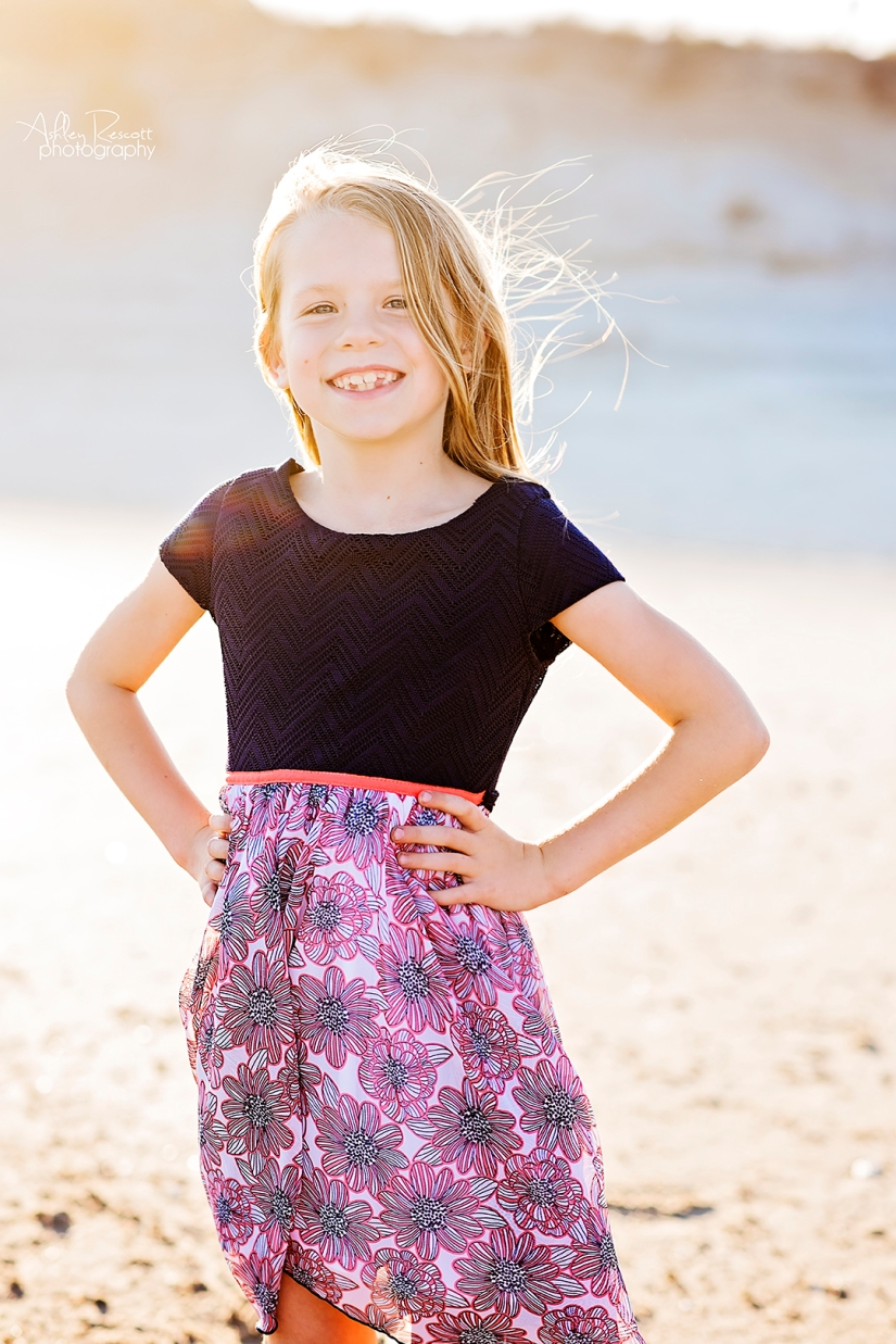sassy girl on beach with her hands on her hips