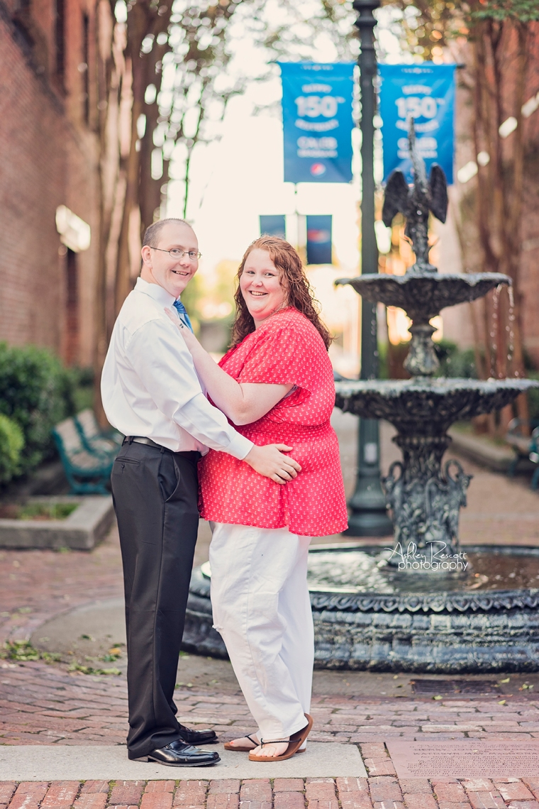 couple in front of fountain in new bern nc