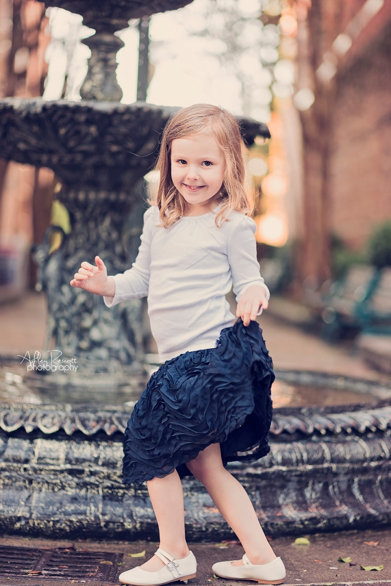 little girl dancing in front of fountain in new bern nc