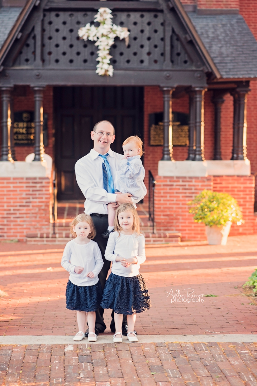 dad and kids standing in front of church in new bern nc