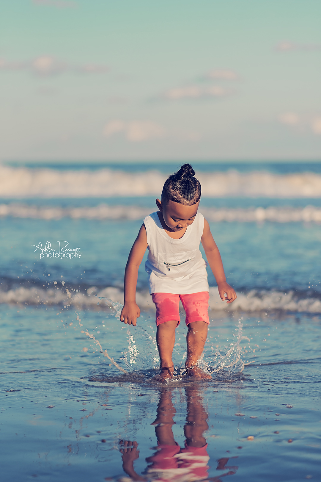 little boy splashing in ocean