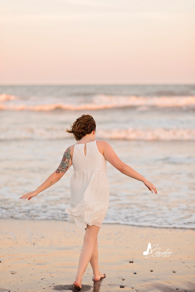 woman in white dress walking on beach