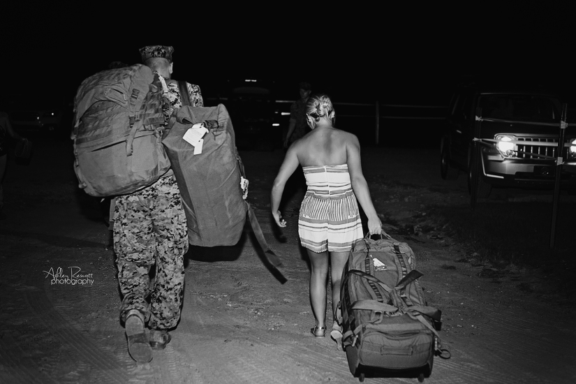 military couple walking with gear