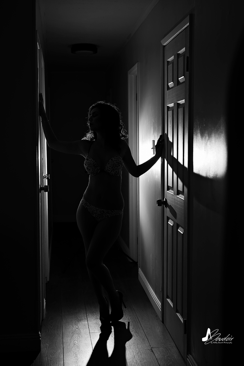silhouette of a woman in a hallway