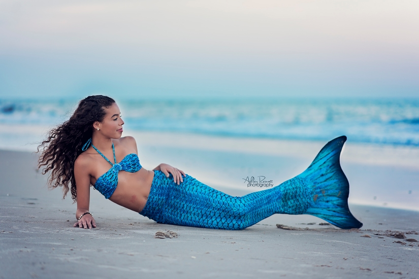 mermaid laying on beach