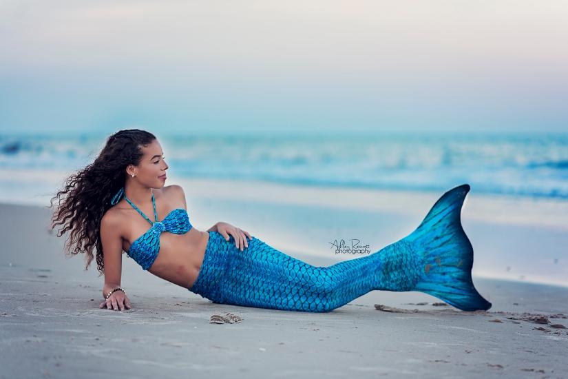 mermaid laying on beach