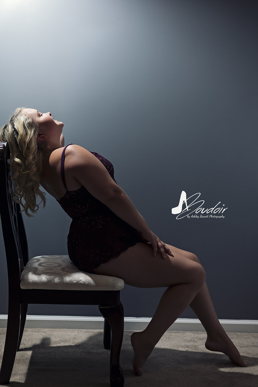 blonde bombshell on chair