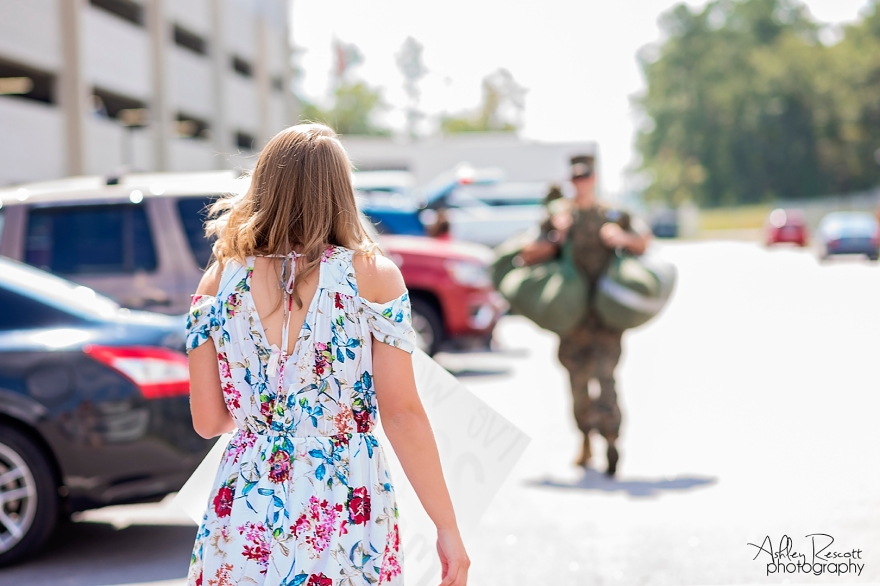 wife walking toward her marine