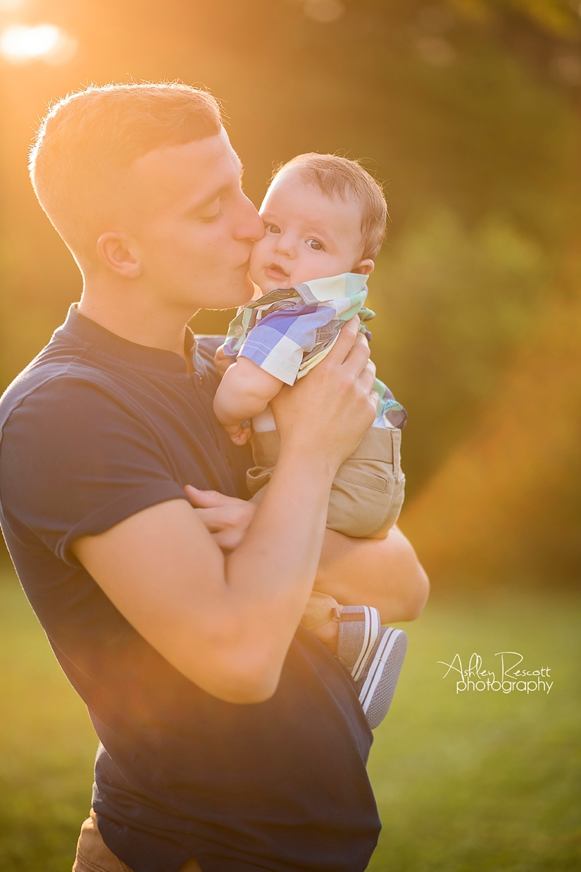 portrait of father and son with sunflare