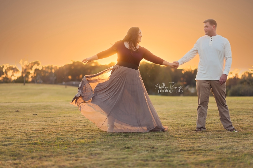couple dancing in field