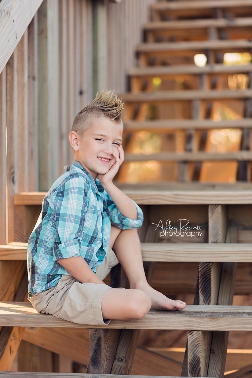 boy on steps on beach house