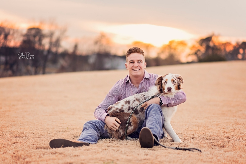 uncle with dog in field at sunset