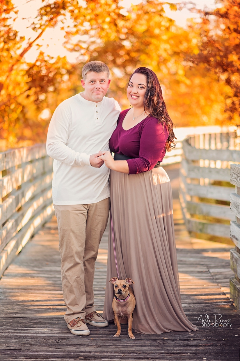 couple and puppy on bridge