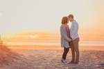 couple at beach during foggy sunrise