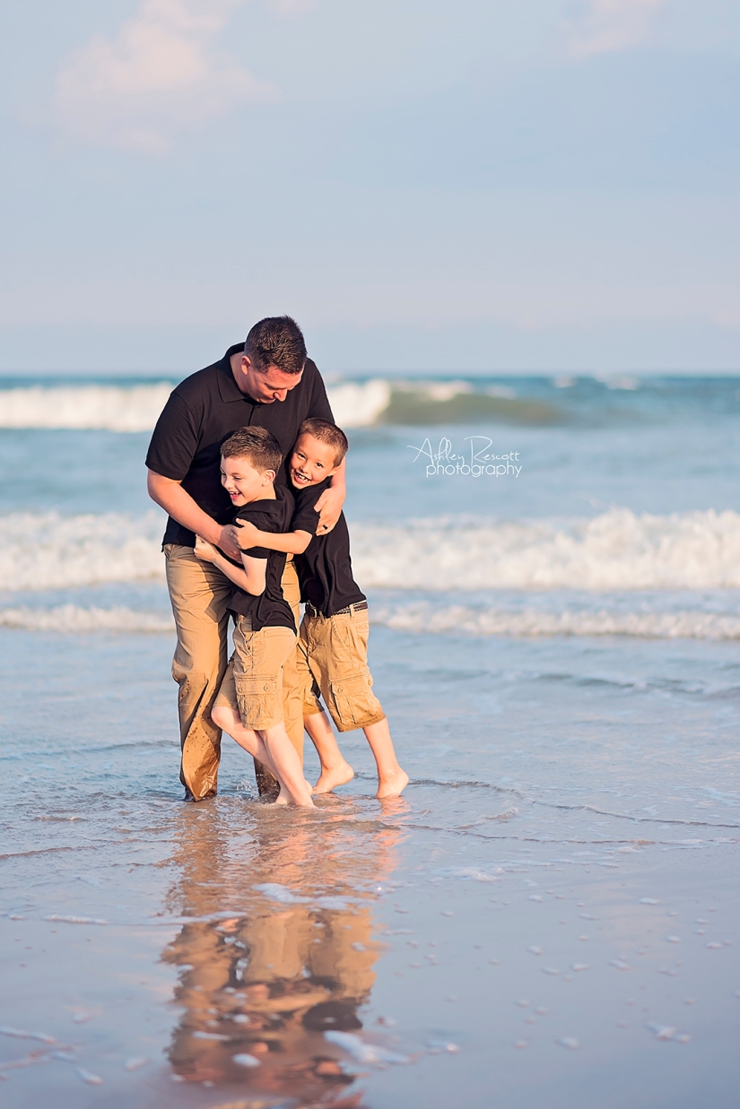 family in water on beach