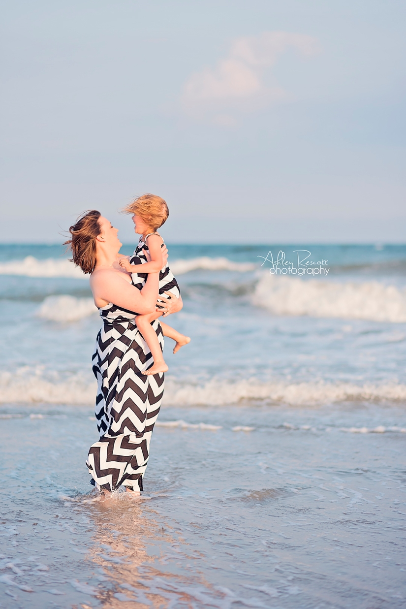 mom and daughter in water on beach