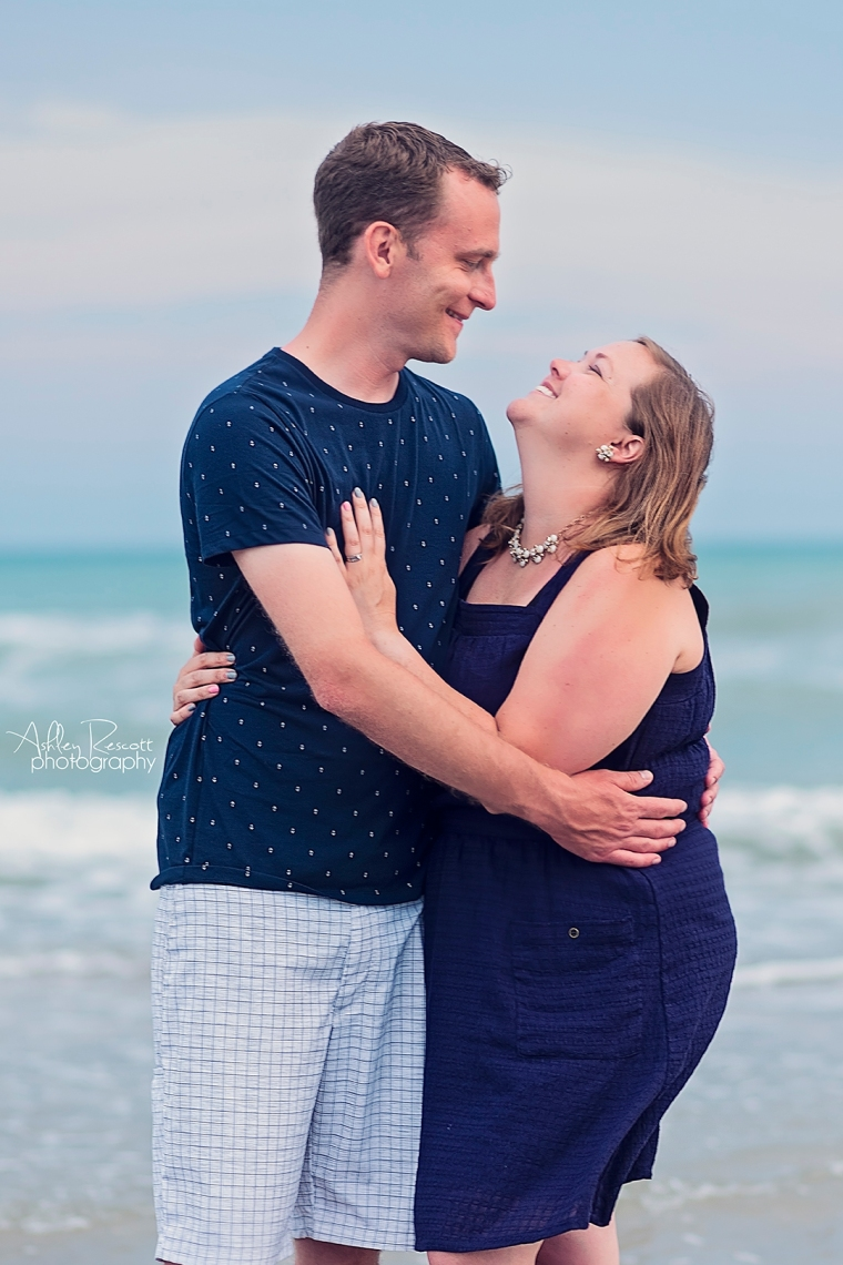 laughing couple at beach