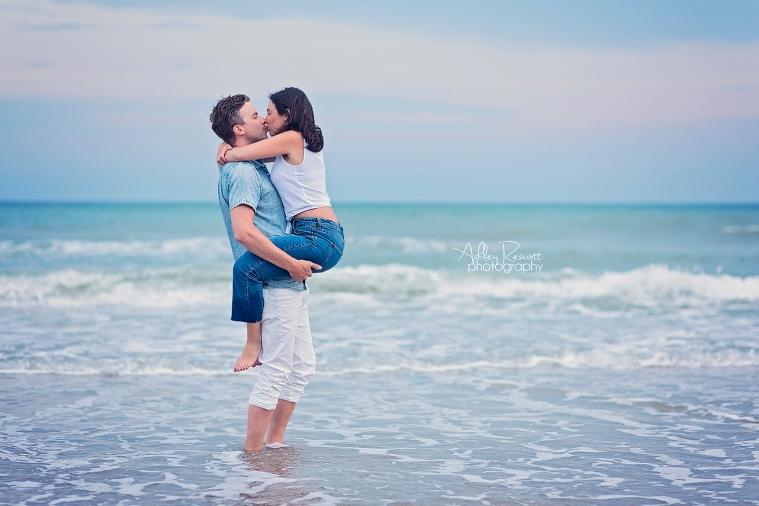kissing couple at beach