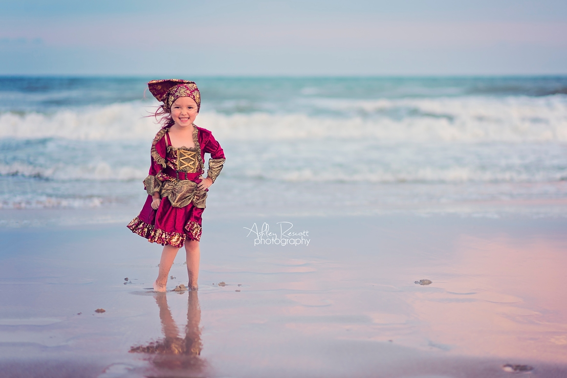 Little girl pirate on beach