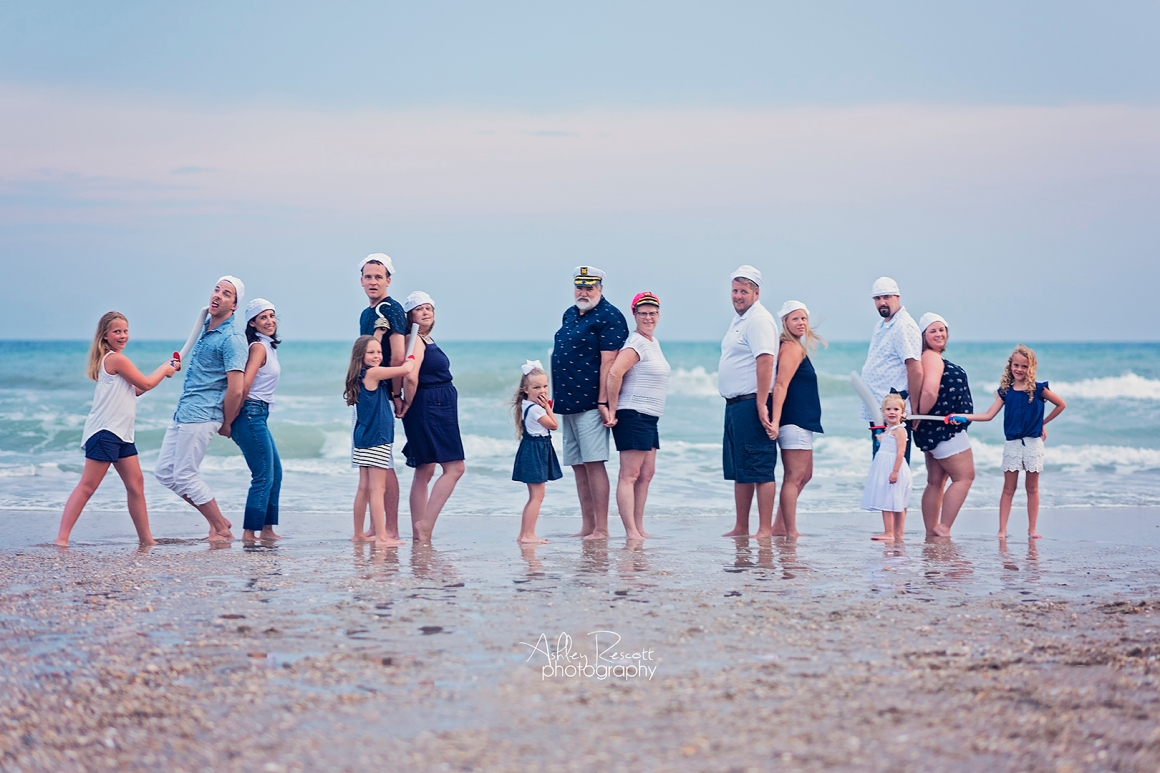 large family having fun at beach