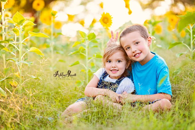 Brother and sister in sunflower field