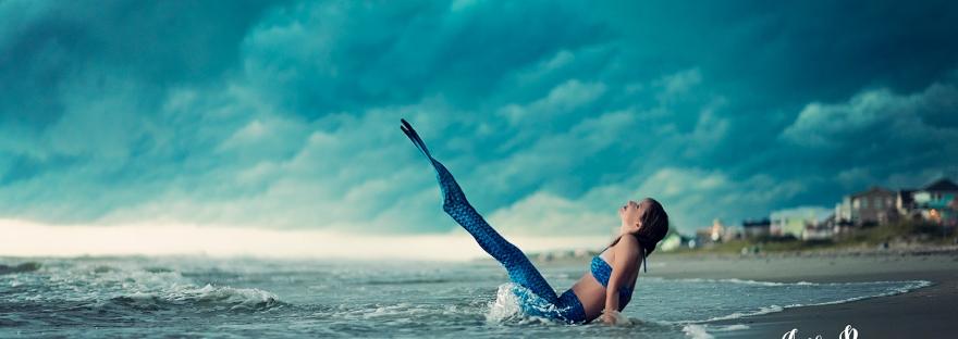 mermaid on beach with stormy skies